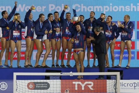 Serbia celebrate after taking the gold during the medal ceremony after the Men's final of the European Water Polo Championships between Spain and Serbia in Barcelona, Spain, Saturday, July 28, 2018. (AP Photo/Manu Fernandez)