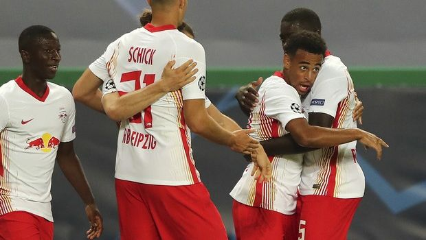 Leipzig's Tyler Adams, right, celebrates after scoring his side's second goal during the Champions League quarterfinal match between RB Leipzig and Atletico Madrid at the Jose Alvalade stadium in Lisbon, Portugal, Thursday, Aug. 13, 2020. (Miguel A. Lopes/Pool Photo via AP)