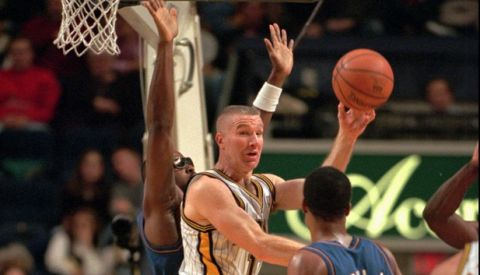 Indiana Pacers' Chris Mullin, center, passes the ball as he drives through the lane while Washington Wizards Harvey Grant, rear, and Rod Strickland (1) defend during the second quarter in Indianapolis on Saturday, Dec. 13, 1997. (AP Photo/Tom Strattman)