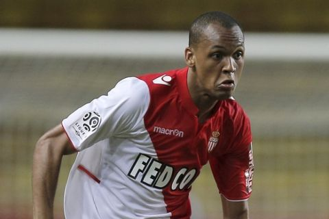 Monaco's Fabinho of Brazil runs for the ball during his French League One soccer match against Toulouse, in Monaco stadium, Friday, Aug. 23, 2013. The match is being played at the empty stadium because of earlier fans trouble during the match against Le Mans on May, 2013. (AP Photo/Lionel Cironneau)