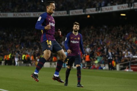 FC Barcelona's Coutinho celebrates after scoring during the Spanish La Liga soccer match between FC Barcelona and Real Sociedad at the Camp Nou stadium in Barcelona, Spain, Sunday, May 20, 2018. (AP Photo/Manu Fernandez)