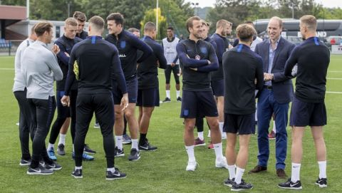 Britain's Prince William, second right, talks to members of the England soccer team, during his visit to the FA training ground to meet players ahead of their friendly match against Costa Rica, in Leeds, England, Thursday, June 7, 2018. (Charlotte Graham/Pool Photo via AP)