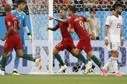 Portugal's Ricardo Quaresma, third right celebrates after scoring the opening goal of the game during the group B match between Iran and Portugal at the 2018 soccer World Cup at the Mordovia Arena in Saransk, Russia, Monday, June 25, 2018. (AP Photo/Francisco Seco)