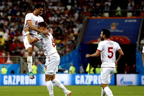 Tunisia's Fakhreddine Ben Youssef (8) celebrates with his teammates after scoring his side's first goal during the group G match between Panama and Tunisia at the 2018 soccer World Cup at the Mordovia Arena in Saransk, Russia, Thursday, June 28, 2018. (AP Photo/Darko Bandic)
