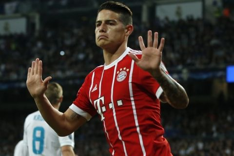 Bayern's James celebrates after scoring his side's second goal during the Champions League semifinal second leg soccer match between Real Madrid and FC Bayern Munich at the Santiago Bernabeu stadium in Madrid, Spain, Tuesday, May 1, 2018. (AP Photo/Paul White)