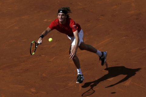 Greece's Stefanos Tsitsipas returns the ball to Spain's Rafael Nadal during the Barcelona Open Tennis Tournament final in Barcelona, Spain, Sunday, April 29, 2018. (AP Photo/Manu Fernandez)