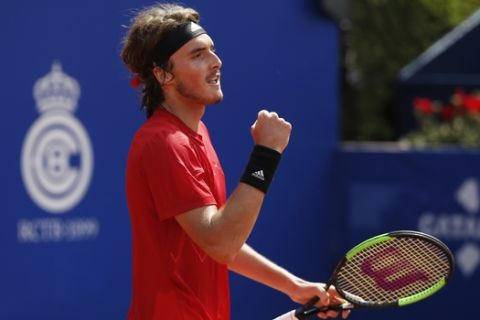 Stefanos Tsitsipas of Greece celebrates scoring a point in his semifinal match against Spain's Pablo Carreno Busta during the Barcelona Open Tennis Tournament in Barcelona, Spain, Saturday, April 28, 2018. (AP Photo/Manu Fernandez)