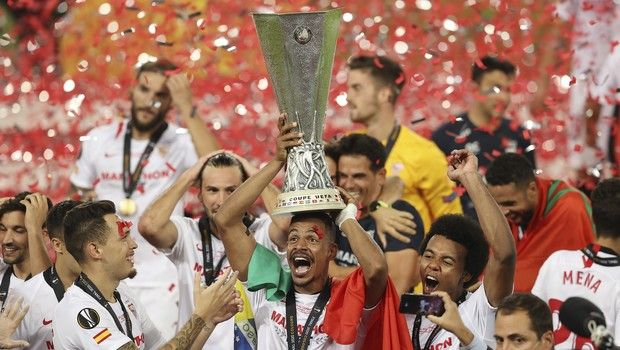 Sevilla's Fernando holds the trophy after winning the Europa League final soccer match between Sevilla and Inter Milan in Cologne, Germany, Friday, Aug. 21, 2020. (Lars Baron, Pool Photo via AP)