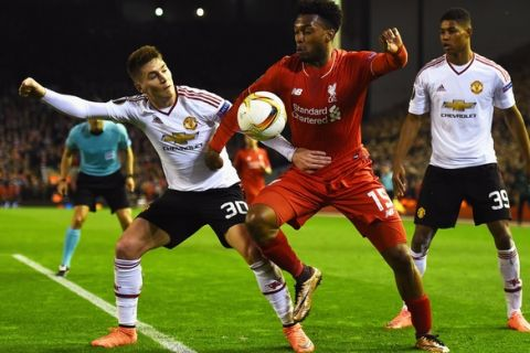 """""""LIVERPOOL, ENGLAND - MARCH 10:  Daniel Sturridge of Liverpool takes on Guillermo Varela (30) and Marcus Rashford of Manchester United (39) during the UEFA Europa League Round of 16 first leg match between Liverpool and Manchester United at Anfield on March 10, 2016 in Liverpool, United Kingdom.  (Photo by Laurence Griffiths/Getty Images)"""""""