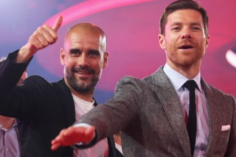 In this May 14, 2016 picture Bayern Munich  head Coach, Pep Guardiola, left,  and soccer player Xabi Alonso  celebrate  during the FC Bayern  Munich  Bundesliga Champions Dinner in Munich, Germany.  ( Lars Baron/Pool Photo via AP)