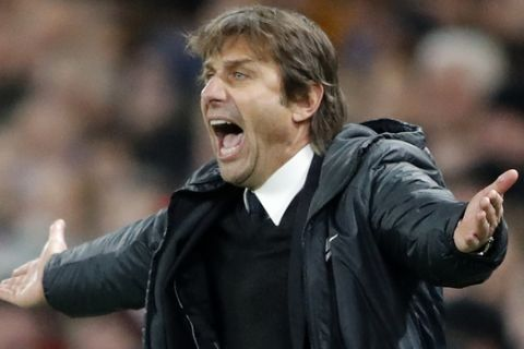 Chelsea coach Antonio Conte screams during the Champions League Group C soccer match between Chelsea and Atletico Madrid at Stamford Bridge stadium in London Tuesday, Dec. 5, 2017. (AP Photo/Frank Augstein)