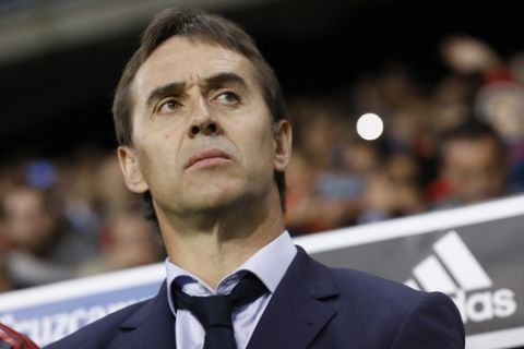 Spain coach Julen Lopetegui stands by bench during the international friendly soccer match between Spain and Costa Rica in Malaga, Spain, Saturday, Nov. 11, 2017. (AP Photo/Miguel Morenatti)