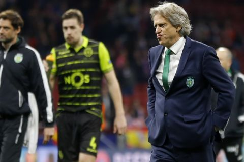 Sporting coach Jorge Jesus, right, and defender Sebastian Coates, 2nd left, walk on the pitch at the end of the Europa League quarterfinal first leg soccer match between Atletico Madrid and Sporting CP at the Metropolitano stadium in Madrid, Thursday, April 5, 2018. Atletico won 2-0. (AP Photo/Francisco Seco)