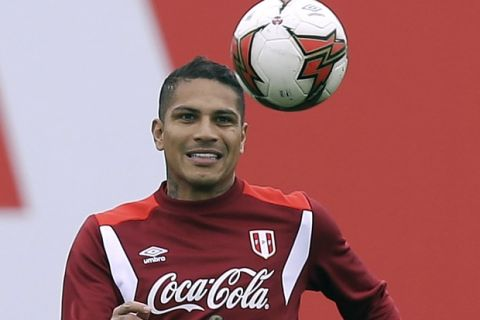 """FILE - In this Sunday, Oct. 8, 2017 file photo, Peru's Paolo Guerrero trains for his upcoming World Cup qualifying match in Lima, Peru. Peru captain Paolo Guerrero will be eligible for next year's World Cup after FIFA reduced his suspension for doping from one year to six months. FIFA announced Wednesday, Dec. 20 that its disciplinary committee considered the six-month ban a proportionate sanction """"after taking into account all circumstances of the case."""" (AP Photo/Martin Mejia, file)"""