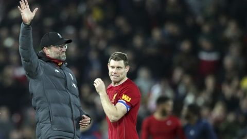 Liverpool's manager Jurgen Klopp, left, celebrates at the end of the English League Cup soccer match between Liverpool and Arsenal at Anfield stadium in Liverpool, England, Wednesday, Oct. 30, 2019. (AP Photo/Jon Super)