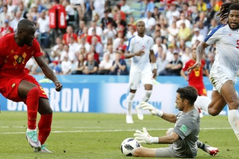 Panama goalkeeper Jaime Penedo, second from right, saves the ball kicked by Belgium's Romelu Lukaku, left, during the group G match between Belgium and Panama at the 2018 soccer World Cup in the Fisht Stadium in Sochi, Russia, Monday, June 18, 2018. (AP Photo/Antonio Calanni)
