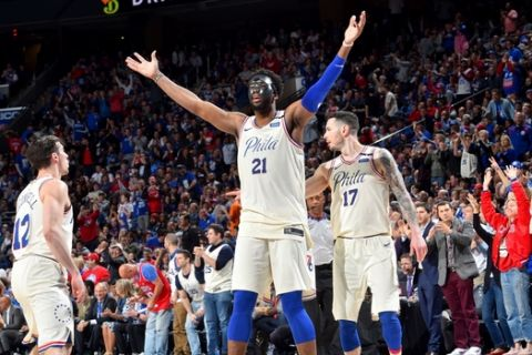 PHILADELPHIA, PA - APRIL 24: Joel Embiid #21 of the Philadelphia 76ers reacts during the game against the Miami Heat in Game Five of Round One of the 2018 NBA Playoffs on April 24, 2018 at Wells Fargo Center in Philadelphia, Pennsylvania. NOTE TO USER: User expressly acknowledges and agrees that, by downloading and or using this photograph, User is consenting to the terms and conditions of the Getty Images License Agreement. Mandatory Copyright Notice: Copyright 2018 NBAE (Photo by Jesse D. Garrabrant/NBAE via Getty Images)