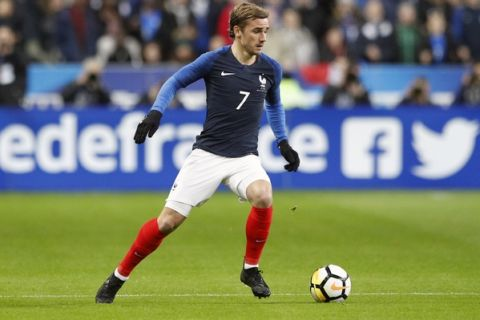 France's Antoine Griezmann runs with the ball during a friendly soccer match between France and Colombia at the Stade de France stadium in Saint-Denis, outside Paris, France, Friday March 23, 2018. (AP Photo/Francois Mori)