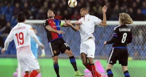"""""""Basel's Argentine midfielder Matias Delgado (2nd L) vies with  Sevilla's French midfielder Steven N'Zonzi (2nd R) vies during the UEFA Europa League round of 16 first leg football match between FC Basel and Sevilla FC on March 10, 2016 at the St Jakob Stadium in Basel. / AFP / FABRICE COFFRINI        (Photo credit should read FABRICE COFFRINI/AFP/Getty Images)"""""""