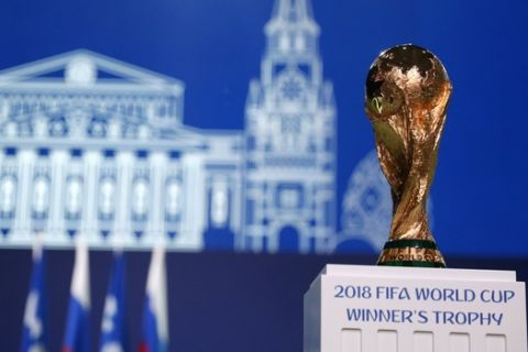 The World Cup trophy is displayed at the FIFA congress on the eve of the opener of the 2018 soccer World Cup in Moscow, Russia, Wednesday, June 13, 2018. The congress in Moscow is set to choose the host or hosts for the 2026 World Cup. (AP Photo/Pavel Golovkin)