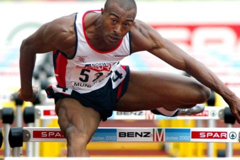 Colin Jackson of Britain clears a hurdle to win his 110m hurdles heat  at the European Athletics Championships in the Olympic Stadium in Munich, Germany, Friday, Aug. 9, 2002. (AP Photo/Michael Probst)