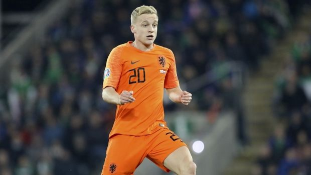 Netherlands' Donny van de Beek runs with the ball during the Euro 2020 group C qualifying soccer match between Northern Ireland and the Netherlands at Windsor Park, Belfast, Northern Ireland, Saturday, Nov. 16, 2019. (AP Photo/Peter Morrison)