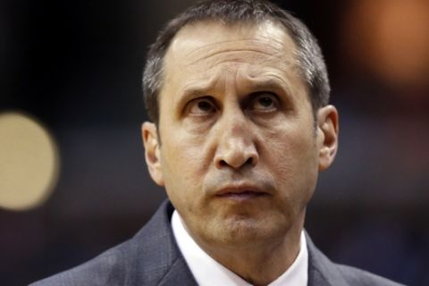 Cleveland Cavaliers head coach David Blatt stands in the bench area in the first half of an NBA basketball game against the Washington Wizards, Wednesday, Jan. 6, 2016, in Washington. (AP Photo/Alex Brandon)