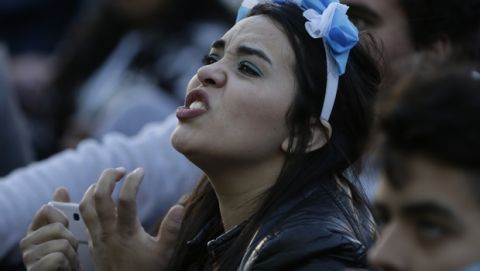 An Argentina fan reacts in disbelief at the end of a televised broadcast of the Croatia vs Argentina World Cup soccer match, in Buenos Aires, Argentina, Thursday, June 21, 2018. Argentina lost 3-0 to Croatia. (AP Photo Jorge Saenz)