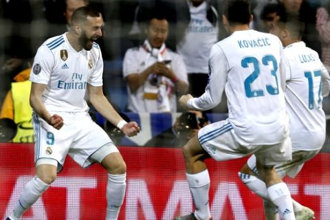 Real Madrid's Karim Benzema, left, celebrates with team mates Mateo Kovacic and Lucas Vazquez after scoring his side's second goal during the Champions League semifinal second leg soccer match between Real Madrid and FC Bayern Munich at the Santiago Bernabeu stadium in Madrid, Spain, Tuesday, May 1, 2018. (AP Photo/Francisco Seco)