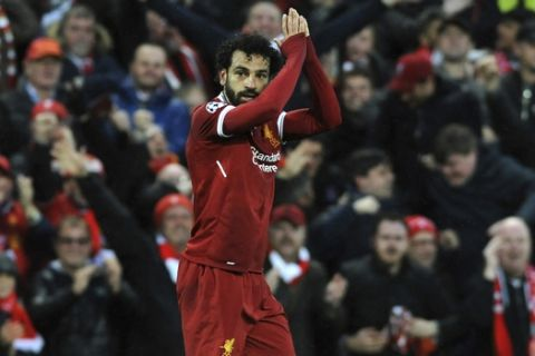 Liverpool's Mohamed Salah celebrates after scoring his side's opening goal during the Champions League semifinal, first leg, soccer match between Liverpool and Roma at Anfield Stadium, Liverpool, England, Tuesday, April 24, 2018. (AP Photo/Rui Vieira)