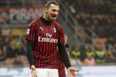 AC Milan's Zlatan Ibrahimovic reacts after missing a scoring chance during the Serie A soccer match between AC Milan and Torino at the San Siro stadium, in Milan, Italy, Monday, Feb. 17, 2020. (AP Photo/Antonio Calanni)