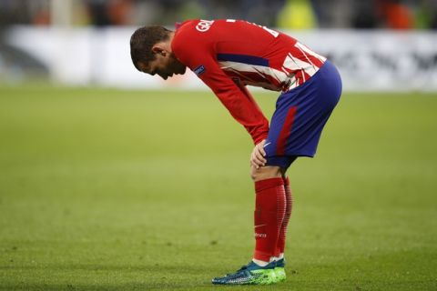 Atletico's Antoine Griezmann pauses during the Europa League Final soccer match between Marseille and Atletico Madrid at the Stade de Lyon in Decines, outside Lyon, France, Wednesday, May 16, 2018. (AP Photo/Francois Mori)