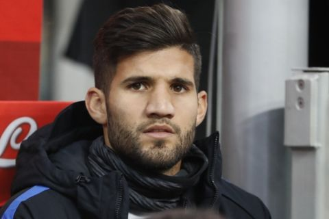 Inter newly acquired Argentine player Lisandro López attends an Italian Serie A soccer match between Inter Milan and AS Roma, at the San Siro stadium in Milan, Italy, Sunday, Jan. 21, 2018. (AP Photo/Antonio Calanni)