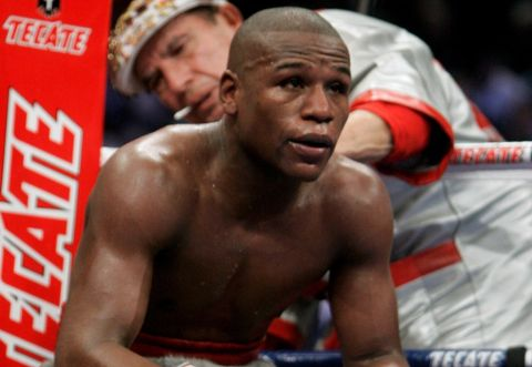 **FILE** In this  Dec. 8, 2007 file photo, Floyd Mayweather Jr., sits on the stool in his corner during a WBC welterweight boxing title fight against Ricky Hatton, of Great Britain, at the MGM Grand hotel-casino in Las Vegas. Mayweather, an Olympic bronze medalist who has won belts in five weight classes, made the abrupt announcement of his retirement in a letter to select media members on Friday, June 6, 2008. (AP Photo/Jae C. Hong, File)