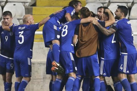 Cyprus' Vincent Laban celebrates his goal with his teammates against Bosnia during their World Cup Group H qualifying soccer match between Cyprus and Bosnia-Herzegovina, at GSP stadium, in Nicosia, Cyprus, Thursday, Aug. 31, 2017. (AP Photo/Petros Karadjias)