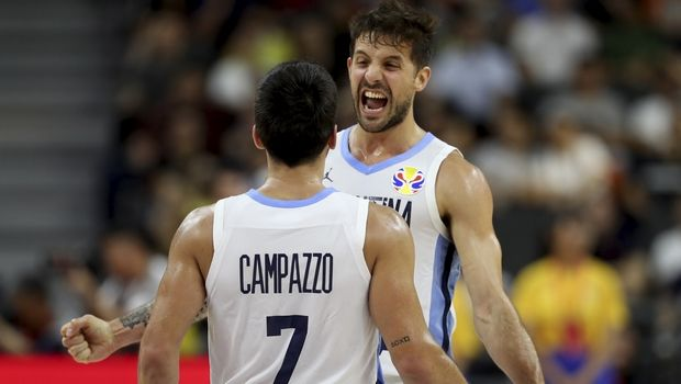 Argentina's Nicolas Laprovittola, at right celebrates with Argentina's Facundo Campazzo after defeating Serbia during a quarterfinal match for the FIBA Basketball World Cup in Dongguan in southern China's Guangdong province on Tuesday, Sept. 10, 2019. Argentina beats Serbia 97-87. (AP Photo/Ng Han Guan)