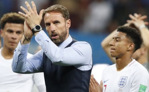England head coach Gareth Southgate walks the field at the end of the semifinal match between Croatia and England at the 2018 soccer World Cup in the Luzhniki Stadium in Moscow, Russia, Wednesday, July 11, 2018. (AP Photo/Rebecca Blackwell)