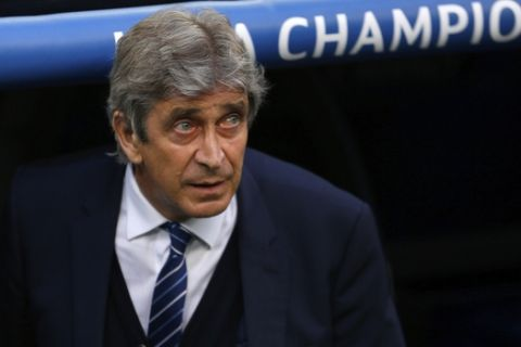 FILE - In this May 4, 2016 file photo, then Manchester City manager Manuel Pellegrini looks out from the bench during the Champions League semifinal second leg soccer match between Real Madrid and Manchester City at the Santiago Bernabeu stadium in Madrid. The spending may have slowed but world-famous coaches such as Fabio Capello and Manuel Pellegrini and players like Hulk and Javier Mascherano still have the same objective in the 2018 Chinese Super League that kicks off on Friday: to stop Guangzhou Evergande from winning an eighth consecutive title. (AP Photo/Francisco Seco, File)