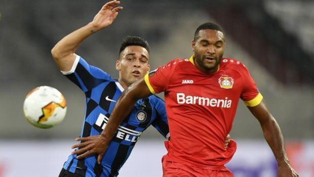 Inter Milan's Lautaro Martinez, left, challenges for the ball with Leverkusen's Jonathan Tah during the Europa League quarter finals soccer match between Inter Milan and Bayer Leverkusen at Duesseldorf Arena, in Duesseldorf, Germany, Monday, Aug. 10, 2020. (AP Photo/Martin Meissner)
