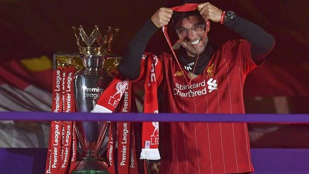 Liverpool's manager Jurgen Klopp puts on his winners medal following the English Premier League soccer match between Liverpool and Chelsea at Anfield Stadium in Liverpool, England, Wednesday, July 22, 2020. Liverpool are champions of the EPL for the season 2019-2020. The trophy is presented at the teams last home game of the season. Liverpool won the match against Chelsea 5-3. (Paul Ellis, Pool via AP)