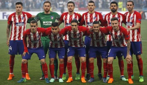 Atletico players line up prior to the Europa League Final soccer match between Marseille and Atletico Madrid at the Stade de Lyon in Decines, outside Lyon, France, Wednesday, May 16, 2018. (AP Photo/Francois Mori)