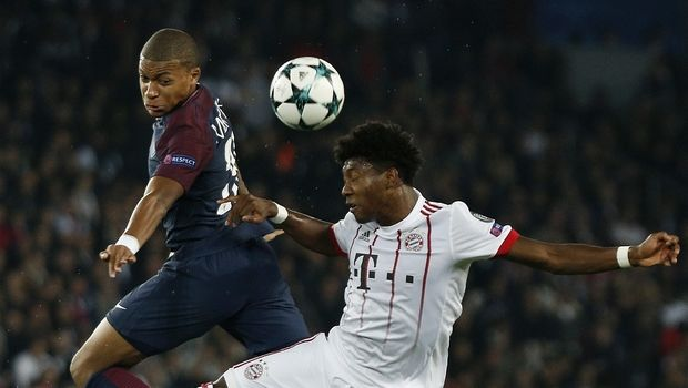 Bayern's David Alaba, right, and PSG's Kylian Mbappe challenge for the ball during the Champions League Group B soccer match between Paris Saint-Germain and Bayern Munich in Paris, France, Wednesday, Sept. 27, 2017. (AP Photo/Thibault Camus)