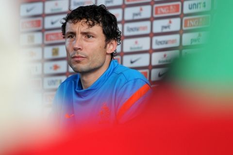 Mark van Bommel from the Netherlands addresses the media after a training session of the Netherlands at the Euro 2012 soccer championships in Krakow, Poland, Wednesday, June 6, 2012. (AP Photo/Geert Vanden Wijngaert)
