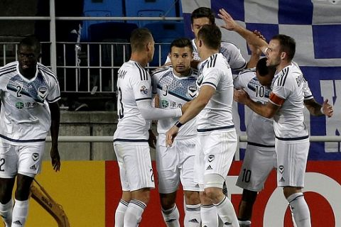 Kosta Barbarouses, third from left, of Australia's Melbourne Victory is greeted by his teammates after scoring a goal against South Korea's Suwon Samsung Bluewings during their Group G soccer match in the AFC Champions League at Suwon World Cup Stadium in Suwon, South Korea, Wednesday, April 6, 2016. The game ended with a 1-1 draw. (AP Photo/Ahn Young-joon)
