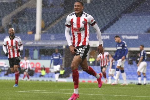 Sheffield United's Daniel Jebbison celebrates after scoring his side's opening goal during the English Premier League soccer match between Everton and Sheffield United at Goodison Park in Liverpool, England, Sunday, May 16, 2021. (Alex Pantling/Pool via AP)