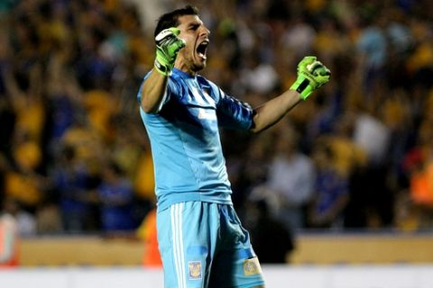 Goalie Nahuel Guzman, of Mexico's Tigres celebrates after his team scored against Argentina's River Plate during a Copa Libertadores soccer match in Monterrey, Mexico, Wednesday, April 8, 2015. (AP Photo/Alfredo Lopez)