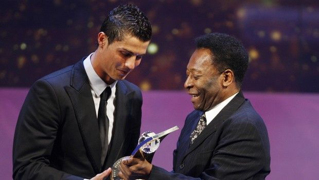 Soccer player Cristiano Ronaldo from Portugal, left, receives the trophy from former Brazilian soccer star Pele, right, after being named FIFA World Player of the Year during the FIFA World Player Gala 2008 at the Opera house in Zurich, Switzerland, Monday, Jan.12, 2009. (AP Photo/KEYSTONE/Steffen Schmidt)