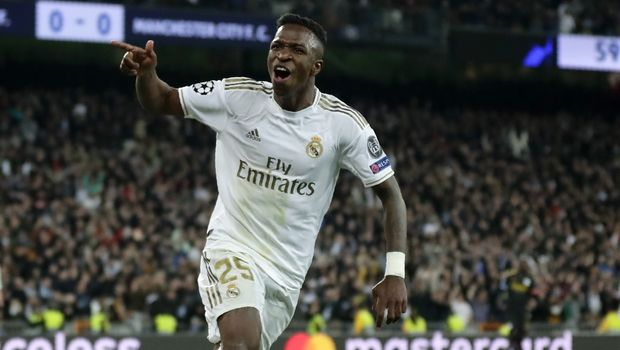 Real Madrid's Vinicius Junior celebrates after Real Madrid's Isco scores his side's opening goal during the Champions League, round of 16, first leg soccer match between Real Madrid and Manchester City at the Santiago Bernabeu stadium in Madrid, Spain, Wednesday, Feb. 26, 2020. (AP Photo/Manu Fernandez)