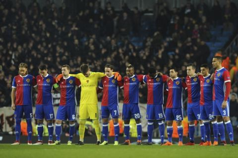 Basel players observe a minute of silence in memory of Fiorentina captain Davide Astori has died in his sleep on Sunday, prior to the start of the Champions League, round of 16, second leg soccer match between Manchester City and Basel at the Etihad Stadium in Manchester, England, Wednesday, March 7, 2018. (AP Photo/Rui Vieira)