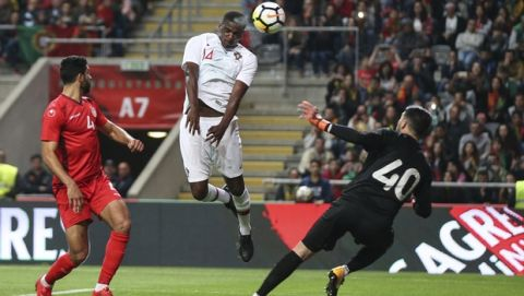 Portugal's William Carvalho, center, heads the ball to score a goal that was disallowed during a friendly soccer match between Portugal and Tunisia in Braga, Portugal, Monday, May 28, 2018. (AP Photo/Luis Vieira)